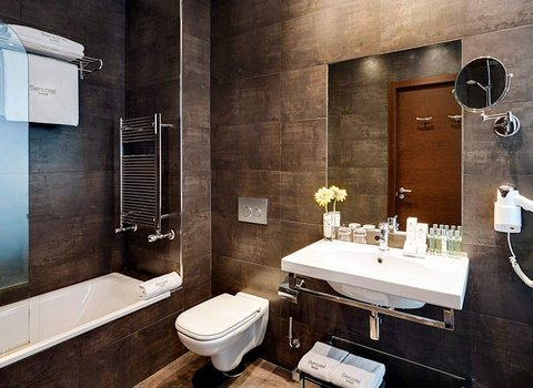 Bathrooms equipped with basic amenities (in standard rooms) and superior ...